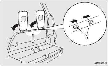 3. Slide the knob while folding the head restraints (C) to the rear, and stow