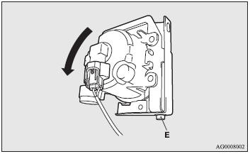 5. In order to secure space to work, remove the bolt (E) and tilt the front fog
